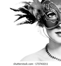 The beautiful young woman in mysterious venetian mask. Black and white photo