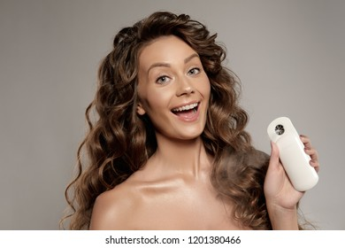 Beautiful young woman with Nano Handy Mist Beauty Humectant Facial Steamer Moisture Skin. Beautiful woman face. Perfect makeup. Beauty fashion. Skin care