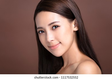 Beautiful young woman with natural makeup and clean skin