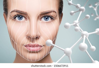 Beautiful young woman near beige glass molecules. Over blue background.