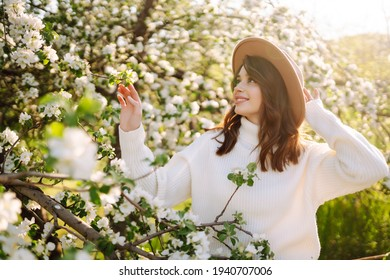 Beautiful young woman near blooming spring tree. Youth, love, fashion, romantic and lifestyle concept.