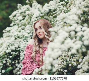 beautiful young woman near the blossoming tree