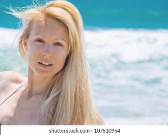 Beautiful young woman near the ocean on Santa Monica. Los Angeles