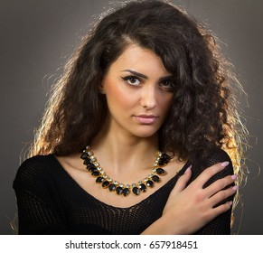 a beautiful young woman with necklace