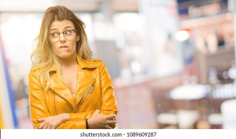 Beautiful young woman nervous and scared biting lips looking camera with impatient expression, pensive at restaurant