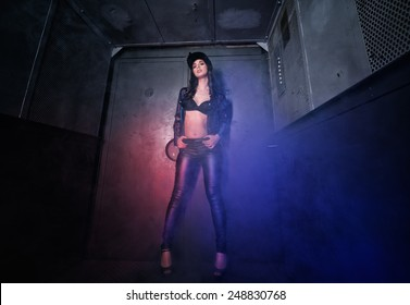 Beautiful young woman in the old elevator