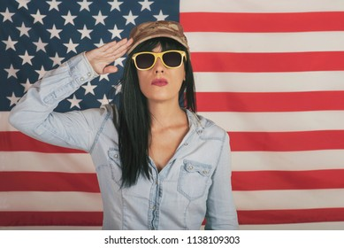 Beautiful young woman on American flag background