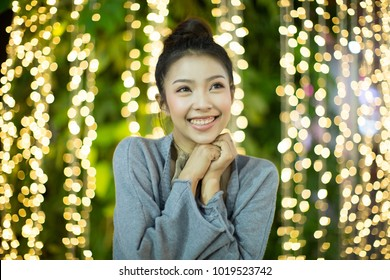 beautiful young woman on a background with bokeh lights