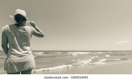 Beautiful young woman on the beach monochrome