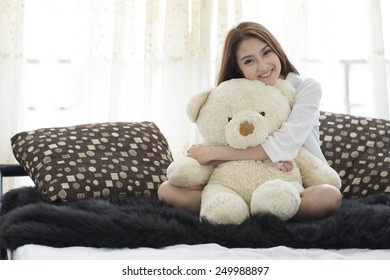 beautiful young woman on the bed