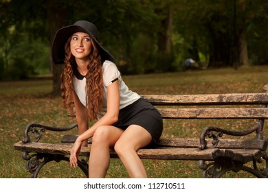 Beautiful young woman on the bench