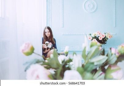 Beautiful young woman on the blue background in the morning