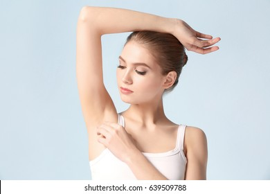 Beautiful young woman on color background. Epilation concept
