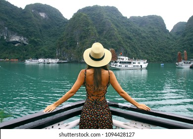 Beautiful young woman on the cruise ship across Halong Bay. Breathtaken landscape in Vietnam