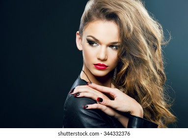 Beautiful young woman on dark background, beauty