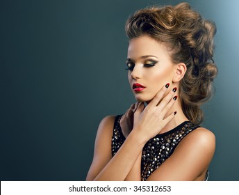 Beautiful young woman on dark background, beauty, glamour