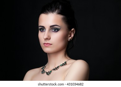 Beautiful young woman on dark background