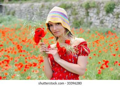 beautiful young woman on field with poppies