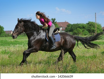 beautiful young woman on a horse