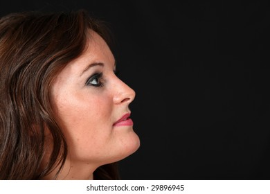 Beautiful Young Woman on Isolated Black Background