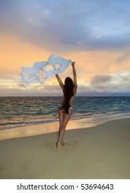 beautiful young woman on lanikai beach at sunrise