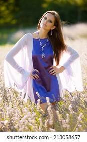 Beautiful young woman on lavander field - lavanda girl in early summer