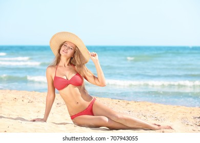 Beautiful young woman on sea beach