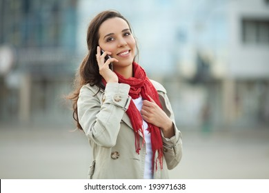 Beautiful young woman on the street on the phone