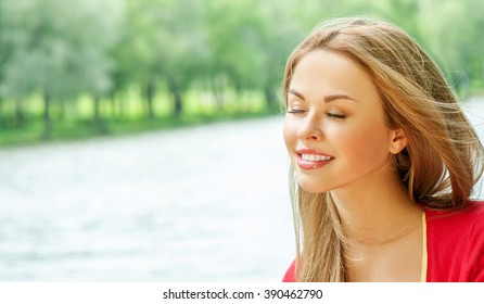 Beautiful Young Woman Outdoors. Enjoy Nature. Beauty Girl Outdoor.