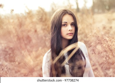 beautiful young woman outdoors in the spring