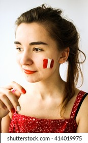 Beautiful young woman with painted austria chile flag on face football olympic games supporter