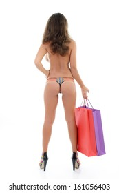 Beautiful young woman in panties only holding shopping bags, full length portrait over white background