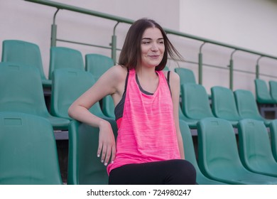 a beautiful young woman in a park with a good mood and desire to go in for sports