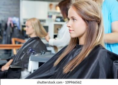 Beautiful young woman at parlor for haircut
