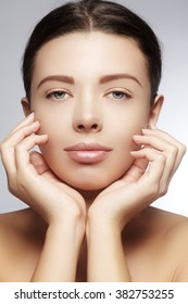 Beautiful young woman with perfect clean shiny skin, natural fashion makeup. Close-up woman, fresh spa look