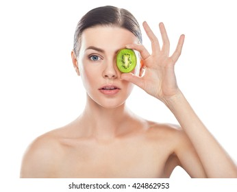 Beautiful young woman with perfect healthy skin holding kiwifruit isolated on white background