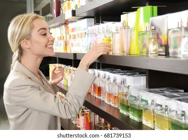 Beautiful young woman in perfumery