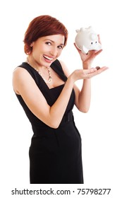 beautiful young woman with piggy bank against white background