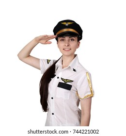 Beautiful young woman in pilot uniform salutes isolated on white background in square