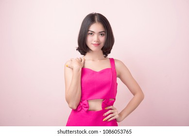 deb681aea5f beautiful young woman in a pink dress on pink background. Fashion photo
