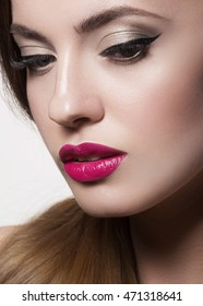 beautiful young woman with pink lips and healthy skin on a white background. Trendy summer makeup