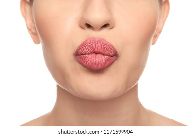 Beautiful young woman with pink lipstick on white background, closeup