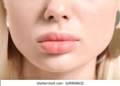 Beautiful young woman with pink lipstick, closeup