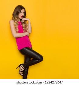 da9e135a0fe Beautiful young woman in pink top
