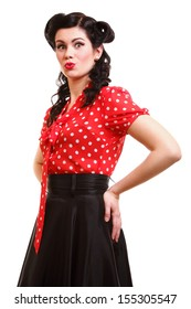 Beautiful young woman with pin-up make-up and hairstyle posing in studio