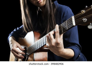 beautiful young woman playing acoustic guitar