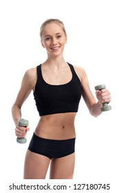 Beautiful young woman playing sports with dumbbells on a white background