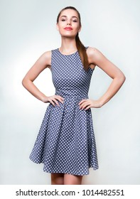 beautiful young woman in polka dot dress