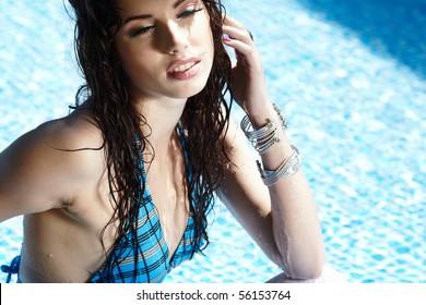 Beautiful young woman at a pool