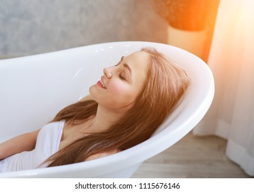 Beautiful young woman portrait in bathroom relax and  preparation take a shower.